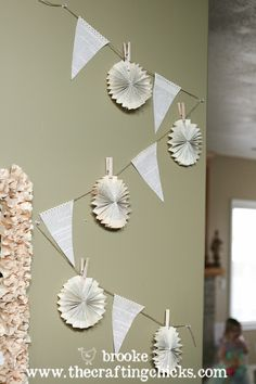 """""""Oh, and in keeping with the pennant and lollies theme (LOL!) I decorated another wall with them for a fun, sort of whimsical feel."""""""