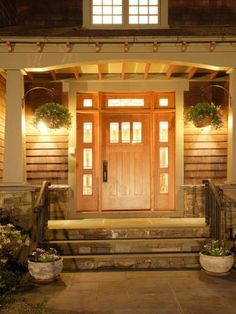 Craftsman entry- columns, stone steps, exposed beams, side lights and transom over door
