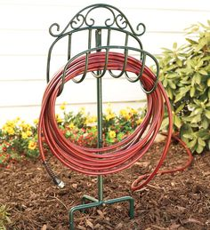 Graceful Scrolls Of Wrought Iron Give Our Lightweight, Movable Hose Holder  An Elegant Appearance That