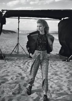 Posing on the beach, the model wears a Mugler jacket and top with Liu Jo pants