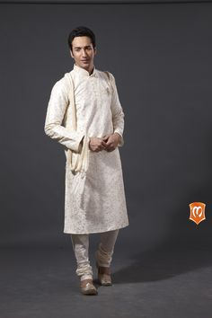 Manyavar royal white poly dupion kurta :- This kurta on poly dupion in off white is one of our master creations.This kurta designed with embroideries all over and sequin decorated neck  makes this outfit a lavish one for all celebrations.  #Manyavar #Kurtas #Wedding #Manyavar Wedding Wear #Indian Wedding Wear #Wedding Collection #Celebration Wear