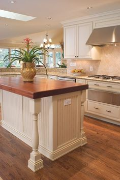 Beautiful renovated 80's kitchen  - island with turned legs, bead board doors Saeple cherry counter top