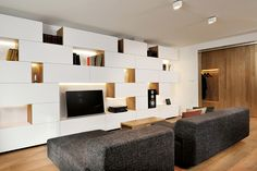 Studio 360 adds walls of modular shelving and storage to Slovenian apartment