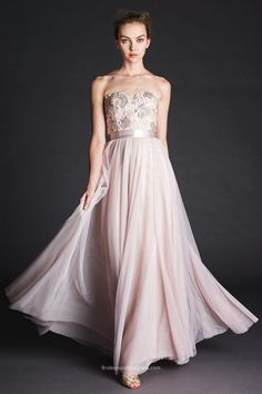 Look gorgeous on this beautiful bridesmaid dress, it has the sequined lace on the bodice and  bobbinet for the skirt, A-line floor length make up a blush bridesmaid gown with strapless dipped neckline. Double-faced satin ribbon at waist.