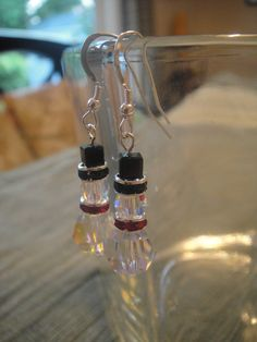 Swarovski Crystal Snowmen earrings by acalabro18 on Etsy, $15.00.  (6/8 rounds, 2 of 6mm roundelles, 4mm cube.)