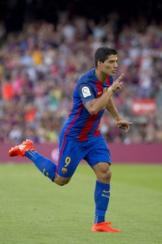 Barcelona's player Luis Suarez celebrates after scoring a goal during the…