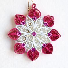 8 point pink and white quilled snowflake with pink glitter