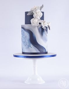 Icy Blue Marble Cake with Chanel inspired camellias by The Enchanting Merchant Company