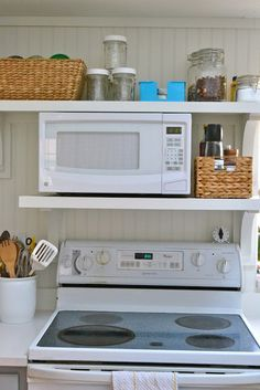 Microwave is taking up too much counter space, considering adding some shelves above the stove like this...