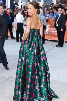 Star of the upcoming The Man from U.N.C.L.E., Alicia Vikander, wore this emerald Erdem gown in 2013 to the Toronto International Film Festival.