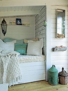 Worn cedar or Whitewashed wood for a headboard wall; driftwood accents. Looks like a great place for a nap !