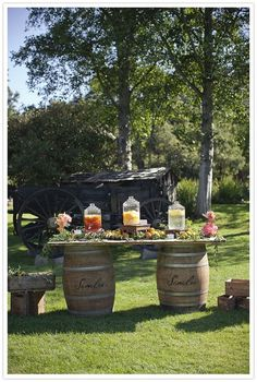 Wine Barrel Tables for beverage stations & tables scattered around hatstacks covered with cloth for a lounge feel