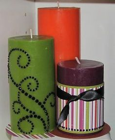 Alter plain candles using scrapbook paper, paint, and ribbon.