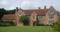 Kirstead Hall, Norwich, Norfolk – A fine Elizabethan Manor house of 'E' shaped plan with stepped Flemish gable ends. The brickwork with attractive blue diaper decoration & pin tiled roof. Thomas Godslave appears to have begun building the house circa 1570  incorporating parts of the previous building which was probably enlarged into its present form by Sir Thomas Spooner.