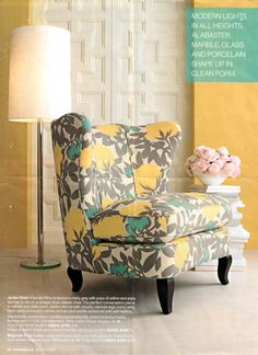 I want this chair! Love the teal and yellow with the grey
