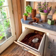 potting shed interior with open shelves, tip-out bin for potting soil