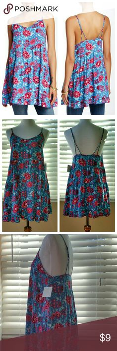 """NWT Free Press Woven Chemise Flirty, fun blue and red flowers with spaghetti straps.  Gathered tiers, ruffle at bottom. 100% rayon. Shoulder to hem = 32"""". Armpit to armpit = 18"""". Also looks great with jeans or leggings.  Smoke and pet free.  Sorry, no trades. Free Press Tops Tunics"""
