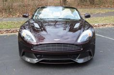 Amethyst Red 2014 Aston Martin Vanquish Volante Convertible  $219,000 http://www.iseecars.com/used-cars/used-aston-martin-for-sale#id=100137323247