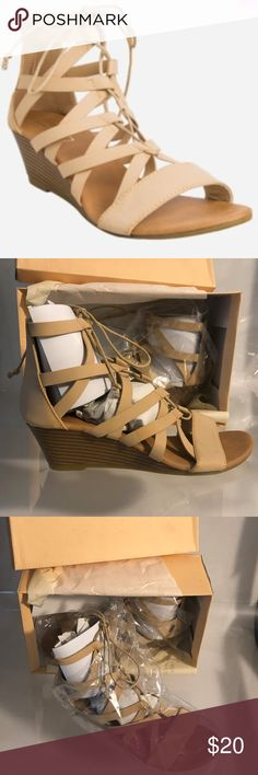 Yoki Beige Gladiator Sandals - 8 This great neutral gladiator sandal by Yoki will go with nearly any outfit you throw at it! Has a 2-inch wedge heel. Open toe. Closed back. Lace up closure. Wood look heel. Manmade materials. Color is Beige Khaki. Measure 3 1/2 inches across the ball of the foot and are about 10 inches long from toe to heel. New in original box. Yoki Shoes Sandals