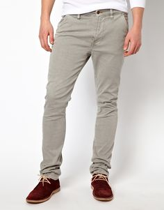 $158, Grey Chinos: Nudie Jeans Nudie Chinos Khaki Slim Fit. Sold by Asos. Click for more info: https://lookastic.com/men/shop_items/131372/redirect