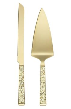 Gold glittering handles provide a festive finish for a polished, special occasion-worthy cake-serving set.