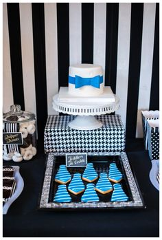 First birthday boy party sweets, cookie and cake display. Pinstripes, bowties, ties patterns and tuxes with black, white, blue and gold details. Popcorn, cakes, sugar cookies, dognuts, ding dongs and oreos!!!