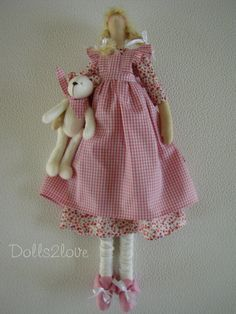 Tilda doll Tammy wearing a dress with a print of by Dolls2love