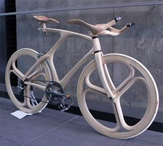 """Unique bicycle made of wood by talented Japanese designer Yojiro Oshima. Bicycle frame, wheels, seat, and handlebar were all sculpted out of wood. Yojiro Oshima, industrial design student at Musashino Art University in Tokyo, created this """"Wooden Bicycle"""" for his final graduation project."""