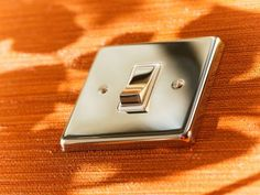 Victorian single rocker switch finished in polished nickel with white interiors.