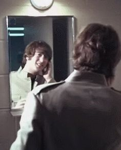 1965 - John Lennon. And that's how it's done, ladies and gentlemen. Beatle hair.
