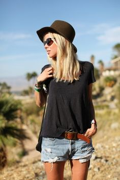 Distressed denim shorts, black slouchy t shirt, black sun hat, brown belt, brown or black flats, and funky accessories.