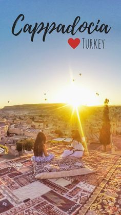 Sunrise in Cappadocia - fairy chimneys and hot air balloons. Here's why Cappadocia is the most magical place on earth.