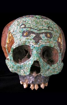 """"""" Human skull decorated with a polychromic mosaic, Mixtec-Aztec, Mexico, A. Tessels of turquoise, hematite and tumbaga gold sheets """" Aztec Mask, Gold Sheets, Aztec Culture, Art Premier, Human Skull, Ancient Artifacts, Skull And Bones, Skull Art, Tribal Art"""