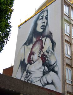 Mother and child - i think this is the same artist and same technique as the cow boy. its in bristol between the centre and cabot circus by a club called Lanes where i earnt my hangover a few weeks ago
