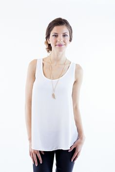 A basic sleeveless top with scoop neck, back yoke, and pleating detail that is perfect for accessorizing.