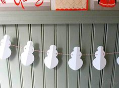 Homemade snowman garland.  So cute!  I have a slight addiction to snowmen!!  I just bought some of that baker's twine...might have to do this garland!  I have the perfect spot for it!!!!