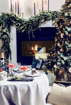 Cozy table scape next to the fireplace and christmas tree
