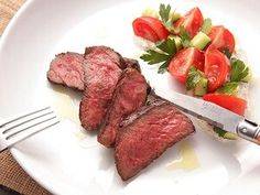 Grilled Strip Steak & Tomato Cucumber Salad  Ingredients  serves Serves 4, active time 25 minutes, total time 1 hour      2 (2-inch thick) New York strip steaks, about 1 pound each     1/2 pound cherry tomatoes, quartered     1 cucumber, seeded, cut into 3/4-inch chunks     Kosher salt and freshly ground black pepper     1/2 cup fresh parsley leaves, divided     1 cup Greek-style yogurt     1 tablespoon juice from 1 lemon, divided     3 tablespoons extra-virgin olive oil, plus more for…