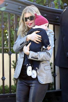 Axl's Merry Day Fergie carried son Axl, 3 months, during a Christmas Day visit with family in L.A.