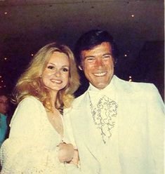 Chris and actress/wife Lynda Day George attend the Country and Western Music Awards in Hollywood, circa mid Lynda Day George, Christopher George, Music Awards, In Hollywood, Love Story, White Dress, Husband, Actresses, Actors