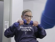 """In """"RBG,"""" a new documentary on Supreme Court Justice Ruth Bader Ginsburg, she is doing pushups, lifting weights and pulling resistance bands. The film is a story about strength -- both the muscle kind and the emotional kind. Pullover, Sweatshirt, Seven Movie, Magnolia Pictures, Justice Ruth Bader Ginsburg, Operation, Best Documentaries, Supreme Court Justices, Women Names"""