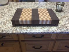 End grain cutting board with legs. Made from walnut, maple and cherry