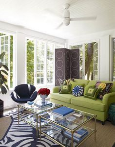 Love the green sofa in this living room. Great pop of color.