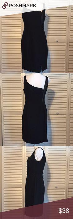 🔥‼️JONES WEAR🔥BLACK ASYMMETRICAL POLYESTER DRESS Jones Wear Women's Black dress. Asymmetrical design on back and front. Zipper on side. Sleeveless. 100% Polyester. Women's size 8. Jones Wear Dresses