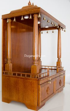 This is our premium collection in medium size open models. This style of pooja mandir is a good choice for clients who have a dedicated pooja room. Base price includes bottom storage with two doors opening down, four 35 Wooden Temple For Home, Temple Design For Home, Temple Room, Home Temple, Modern Wood Desk, Mandir Design, Pooja Mandir, Pooja Room Door Design, Room Partition Designs