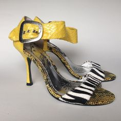 Naughty Monkey Heels These are the Cutest Naughty Monkey Heels. They Look Even Better on. Awesome Bright Yellow Faux Snake Skin with Zebra Patterned Calf Hair. Super Fun And Playful. I love them so much. Unfortunately I just need a half size different.❤️ naughty monkey Shoes Heels