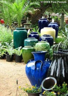 "staggered pottery with plants- tropical! would be neat to do a ""summer blues"" theme -Hill Country Water Gardens in Cedar Park (a suburb north of Austin). Outdoor Topiary, Outdoor Planters, Planter Pots, Blue Garden, Garden Pots, Large Ceramic Planters, Garden Center Displays, Grands Pots, Garden Nursery"