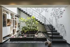 A luxury duplex penthouse in Mumbai. Gond painting on staircase. How to design an apartment with separate public and private spaces. Home Stairs Design, Interior Stairs, House Design, Indian Home Design, Indian Home Decor, Interior Garden, Home Interior Design, Indoor Courtyard, Gond Painting