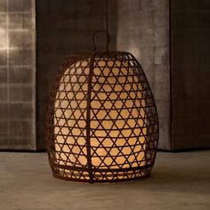 Copper woven basket lamp based on Balinese cock fighting baskets
