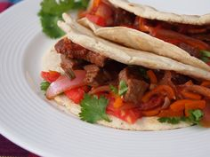 Tacos de Lomo Saltado | As I spend a lot of time in the US, where tacos are one of the most prevalent foods, I started wondering a while ago if any Peruvian dish would make a great taco. Thinking about this, it suddenly came to me that lomo saltado, our scrumptious beef stir-fry of Chinese origin, would make a marriage made in heaven when stuffed inside a corn tortilla in place of the typical rice and French fries that accompany it. | From: perduedelights.com